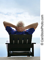 Senior relaxing in a deckchair