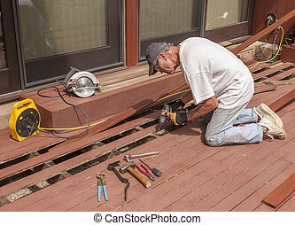 Senior repairing deck