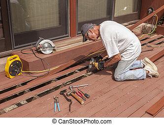 Senior repairing deck - Senior repairing mahogany wooden...