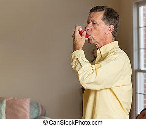 Senior retired man with asthma inhaler