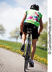 senior riding a bicycle on a road bike - senior fitness...