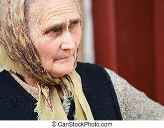 Senior rural woman - Old rural woman with kerchief outdoor
