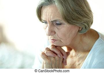 Senior sad woman - Portrait of thoughtful sad elderly woman