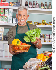 Senior Salesman Selling Vegetables In Store - Happy senior ...