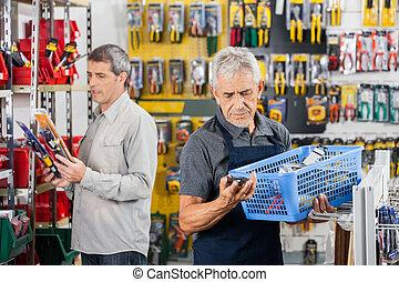 Senior Salesman Working In Hardware Store