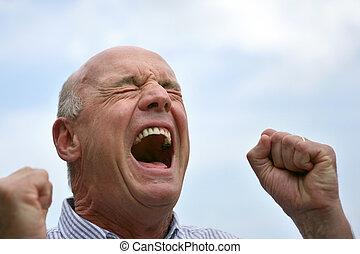 Senior screaming outdoors