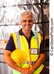 senior shipping company worker in warehouse