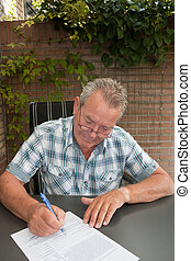 Senior signing a legal conctract