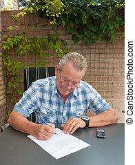 Senior signing a legal document
