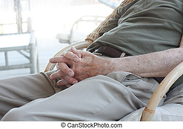 Senior sitting in chair