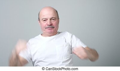 man stretching his arms and hands while warm up - Senior...