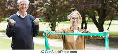 Senior sporty pair exercising