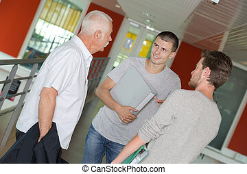 senior student talking to young students