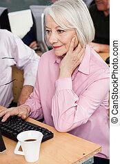 Senior Student Using Desktop PC