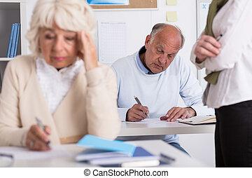 Senior students having exam