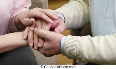 Senior Support - Close-up of senior people supporting each...