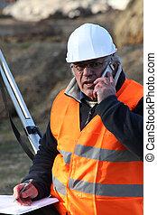 Senior surveyor on construction site