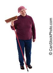 Senior sweeps the floor - old woman sweeps the floor