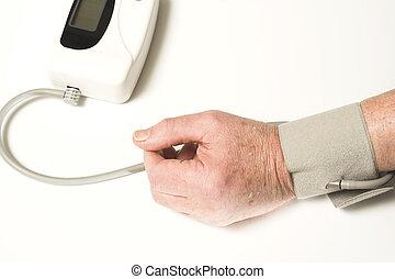 senior taking blood pressure