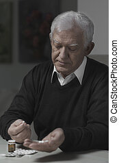 Senior taking pills