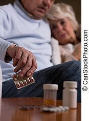 Senior taking tablets