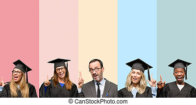 Senior teacher with his graduate students pointing away side with finger