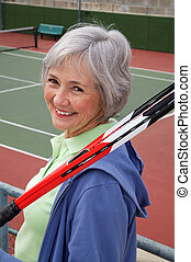 Senior Tennis - Active senior on the tennis court.