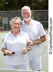 Senior Tennis Players - Active senior couple on the tennis...