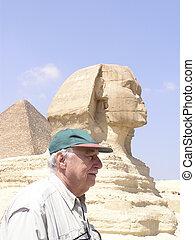 Senior tourist beside Sphinx of Giza
