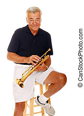 A Senior man proudly holding his trumpet. Isolated on white.