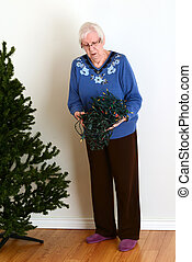 senior trying to untangle christmas