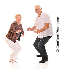 A happy senior couple dancing The Twist, popular in the 60s. On a white background.