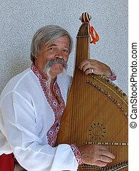 Senior ukrainian traveling musician named kobzar with bandura