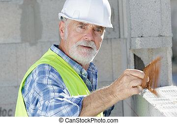 senior, umieszczenie zbudowania, pracujący