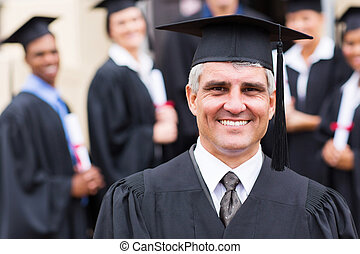 university professor in front of group of graduates