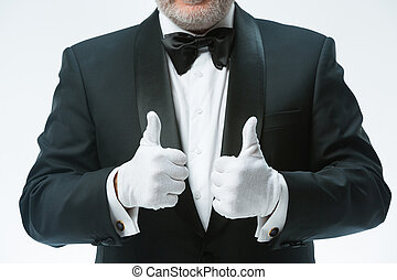 Senior waiter in white gloves - The senior waiter in white...
