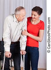 Senior walking with crutches