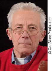 Senior wisdom - Senior man looking over the rim of his ...