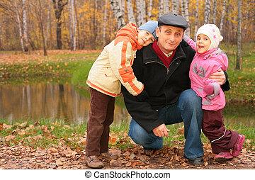 Senior with children on the walk