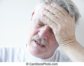 senior with dizziness and head pain - senior with hand on...