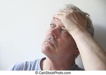 senior with head pain