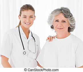 Senior with her nurse looking at the camera