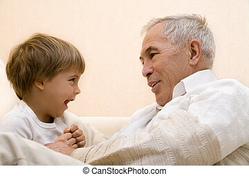senior with his grandchild - Adult senior play about with...