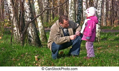 senior with little girl in autumn park - Senior with little...