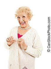 Senior with no Arthritis Symptoms - Senior lady buttons her...
