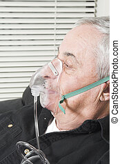 senior with oxygen mask