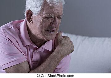 Senior with shoulder pain - Senior suffering from shoulder ...