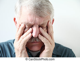 older man has pain in his sinuses