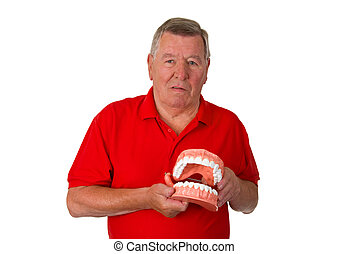 Senior with teeth model