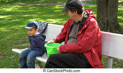 Senior with toddler on bench